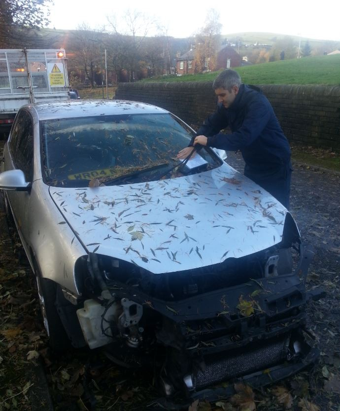 One of our Operations Supervisor's attaching a notice to a car today that meets the criteria of being abandoned